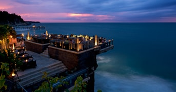 Located on natural rocks 14 meters above the Indian Ocean at the base of AYANA Resort and Spa Balis towering cliffs, this innovative open-top Bali bar is the islands most glam sunset and after-dark destination