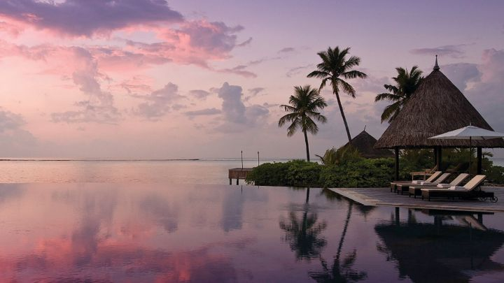 Four Seasons Kuda Huraa Maldives at sunset