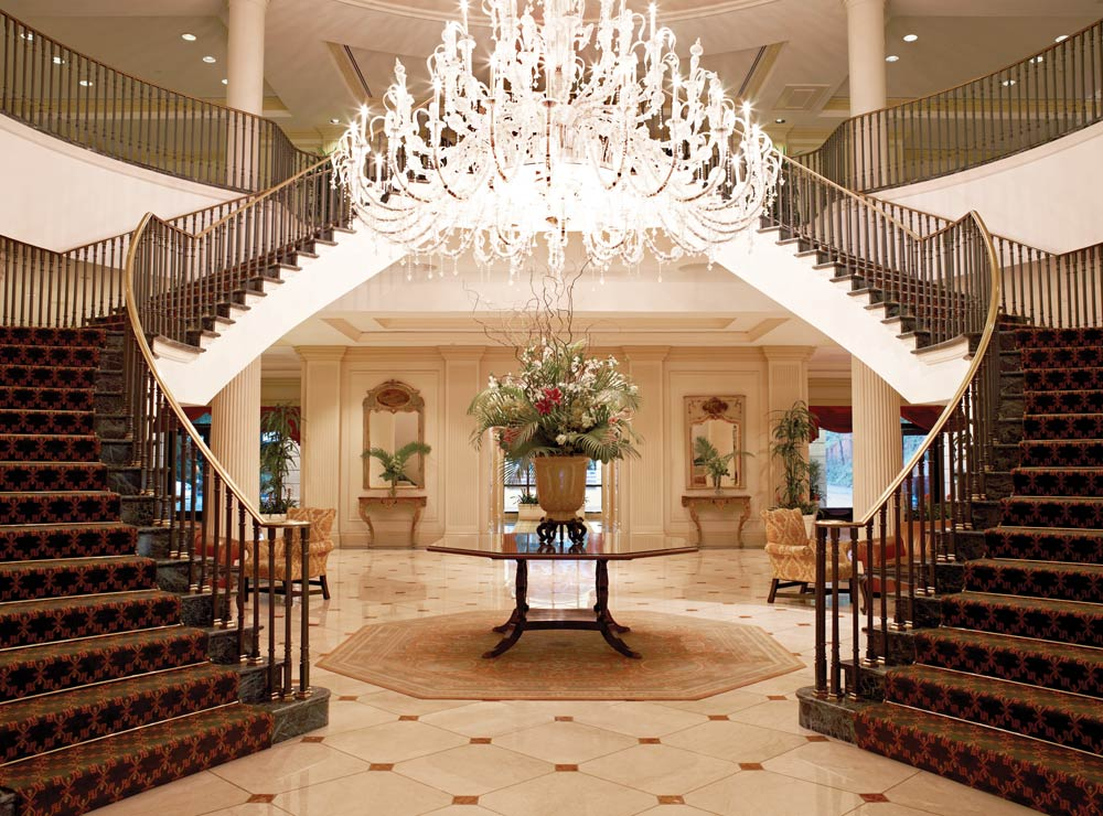 A Georgian open arm staircase greets guests in the lobby at The Belmond Charleston Place Hotel