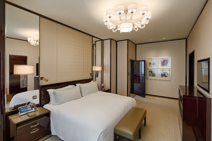The Peninsula Hong Kong Deluxe Suite Bedroom. Located on three sides of the original building of The Peninsula Hong Kong, with views over Hankow Road or the vibrant Middle and Nathan Roads, the Deluxe Room is more spacious than a Superior Room. These elegant rooms retain signature features such as large windows and high ceilings that are transformed with a chic, classically contemporary design aesthetic to maximise space and to discreetly house the ultimate in luxurious creature comforts. From the latest audio-visual technology to high-speed wireless broadband internet access, the Deluxe Room offers everything you would expect from Hong Kong's only truly historic five-star hotel.