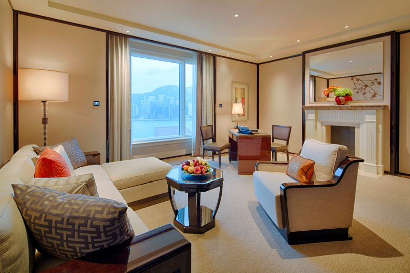 The Peninsula Hong Kong Deluxe Harbour View Suite Living Room. Featuring chic, contemporary classic design enhanced by high ceilings and large windows, a Deluxe Suite affords the ability to comfortably host up to eight guests for dinner or drinks in the dedicated dining area, which doubles as a convenient meeting venue. A separate, luxuriously appointed bedroom features the finest creature comforts, including the latest fully-equipped audio-visual technology, as well as high-speed complimentary wireless broadband internet access to complete a supremely comfortable Deluxe Suite stay.