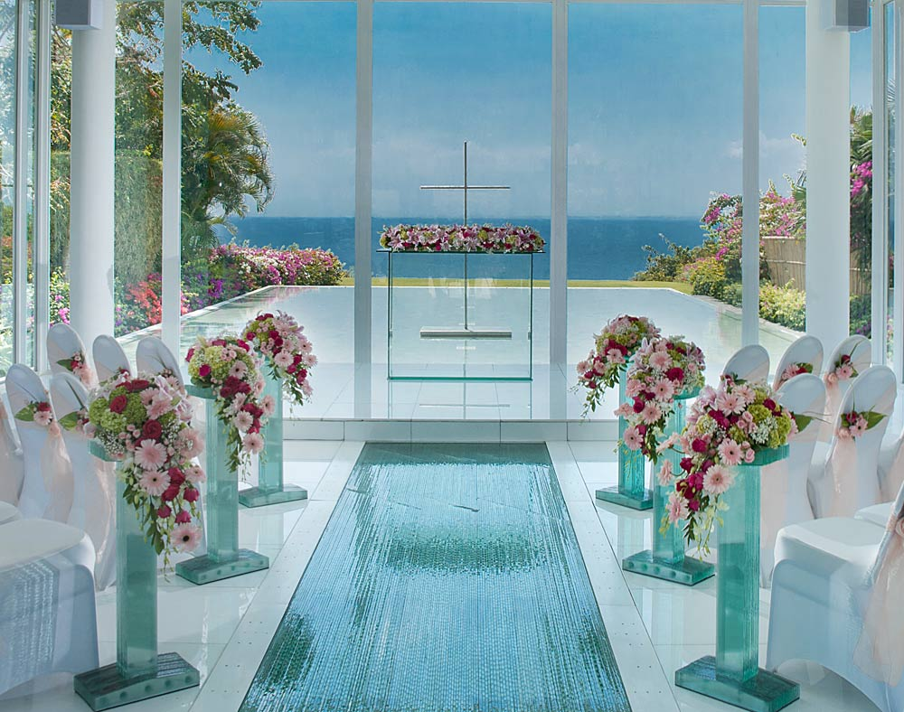 Surrounded by water features and offering stunning Indian Ocean viewsthe glass-sidedindoor Astina wedding chapel in Balibookable through AYANA Resort and Spa Baliis defined by its striking Asian Modern design