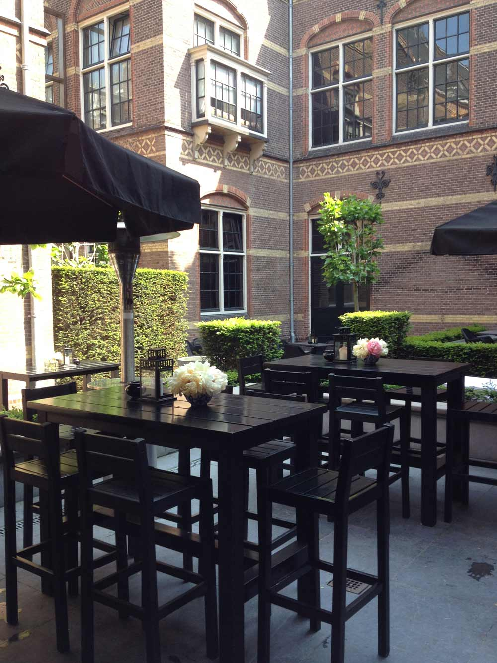 Outdoor lounge area at The College HotelAmsterdam