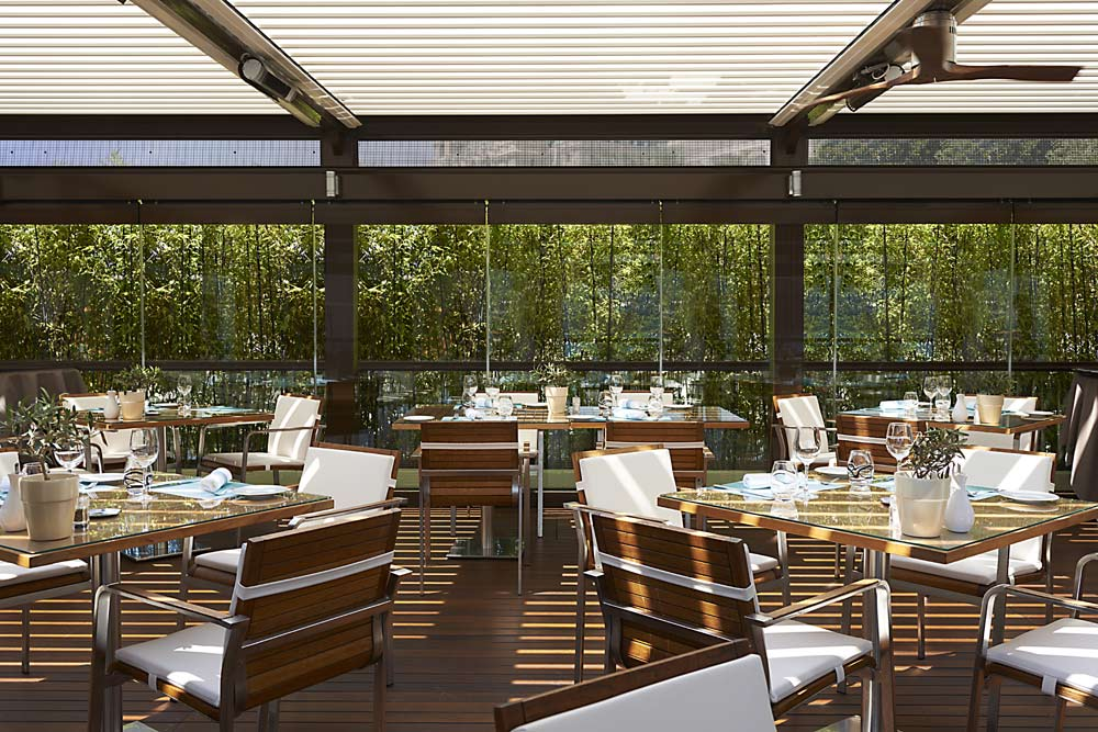 Covered patio dining at Fairmont Monte Carlo, Monaco