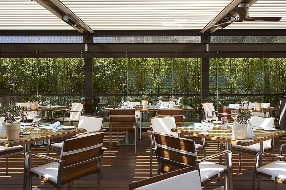 Covered patio dining at Fairmont Monte CarloMonaco
