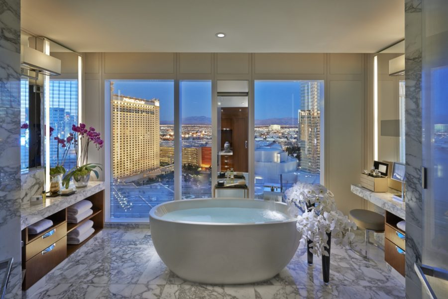 Experience Sin City from an Apex Suite at Mandarin Oriental Las Vegas. In the bedroomtwo glass walls dramatically converge for a 270 degree view of The Strip and CityCenter. In additionguests will enjoy a large glass-enclosed bathroom with walk-in showera stand-alone tubdining areabarand pantry. Goose down bedding and pillow serviceFrette bathrobes and an interactive entertainment system rounds out the reasons to stay in.