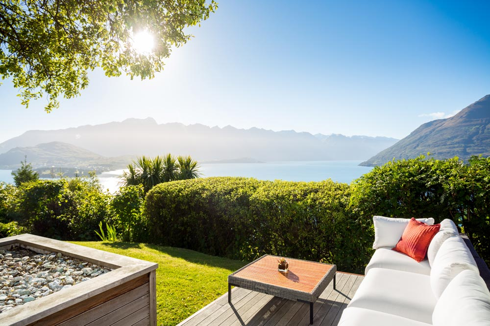Outdoor seating area with panoramic views at Azur Lodge, Queenstown