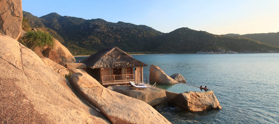 The unique Rock Pool Villas are lapped by the balmy waters of the East Vietnam Sea. Each has a private plunge pool set into the rocks. The villas offer separate sleeping and living areas. They are elegant and spaciouscombining en-suite bathroomswalk-in-closetsseparate vanity areas and handcrafted bathtubs. The villas are accessed by a scenichillside staircase and far from other villasthus ensuring absolute privacy.