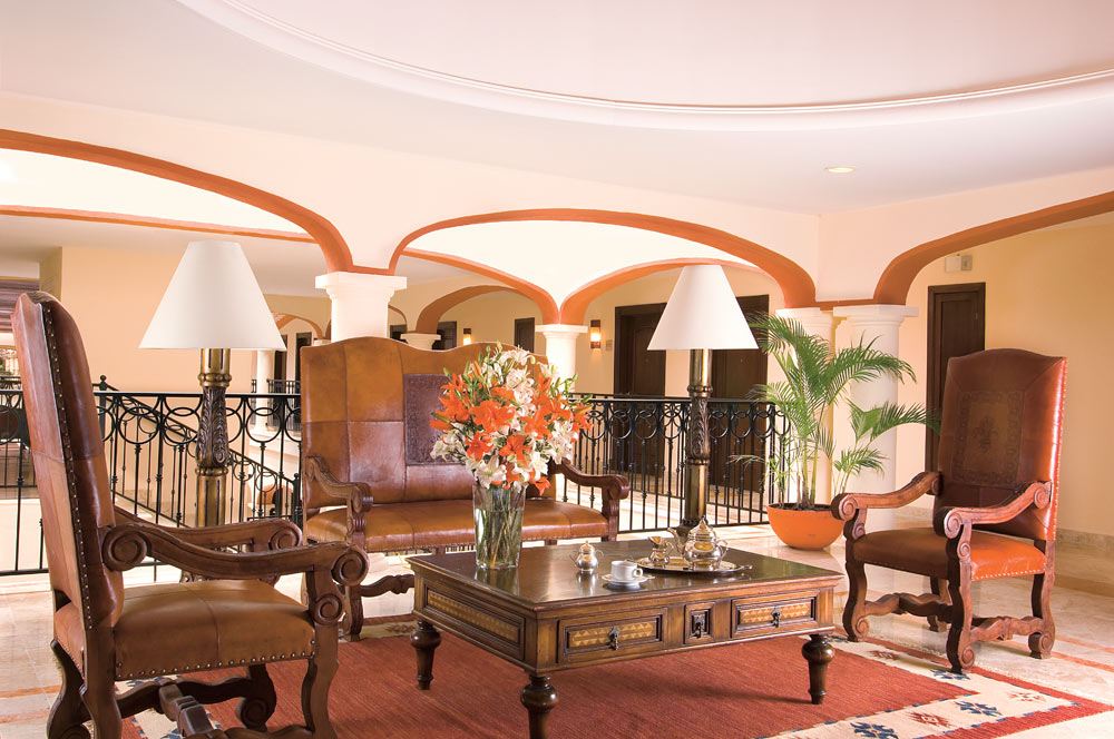 Leather chairs and mahogany furnishings at Secrets Capri Riviera Cancun in Playa Del CarmenMexico
