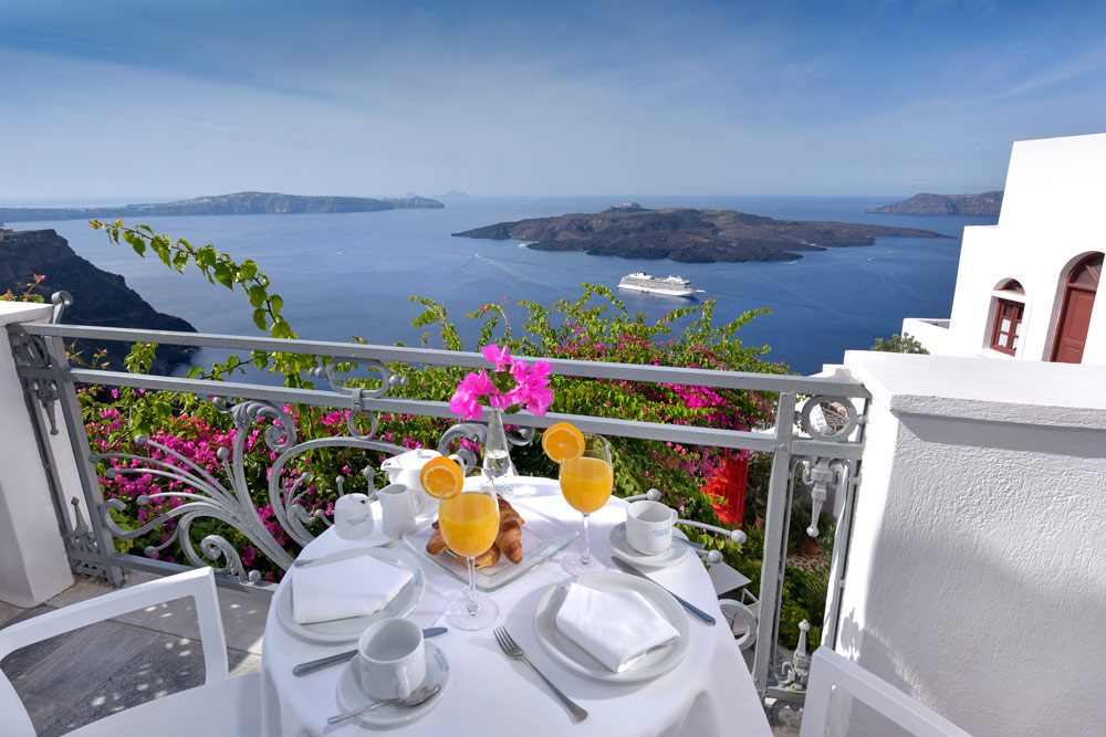 Breakfast on Apiliotis Balcony Overlooking Views at Aigialos HotelSantoriniGreece
