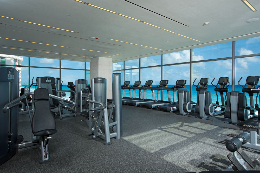 Fitness center overlooks the sparkling Caribbean at Secrets The Vine CancunMexico