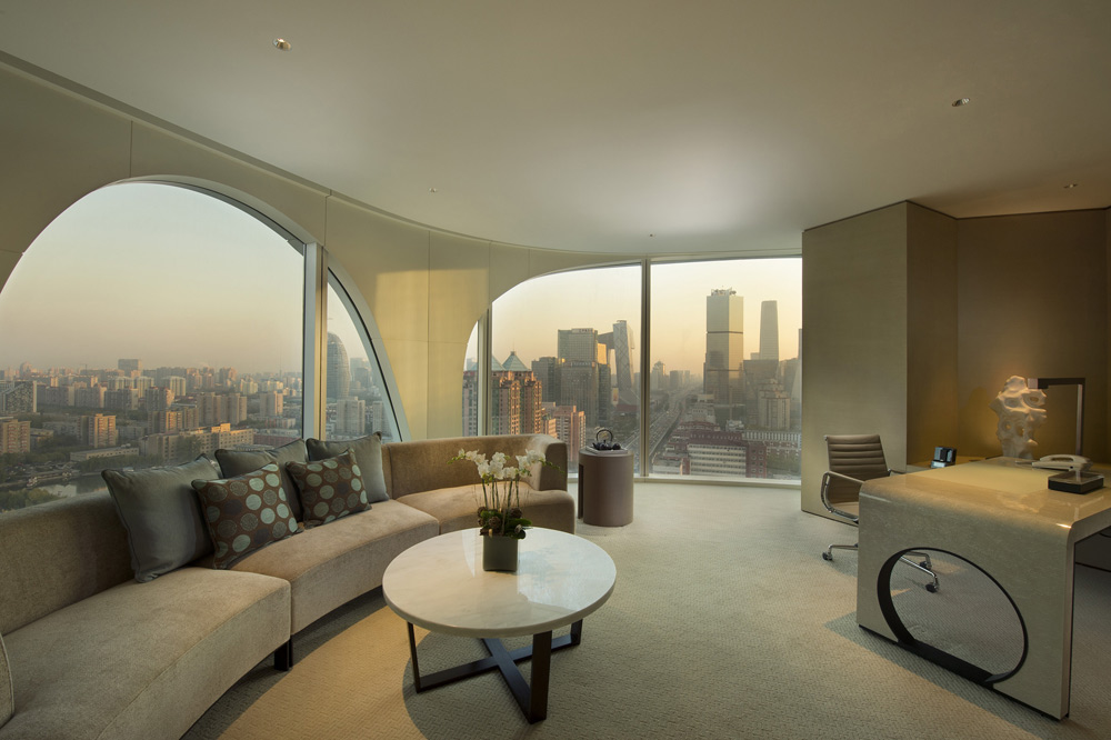 Executive suite living room with city view at Conrad Beijing, China