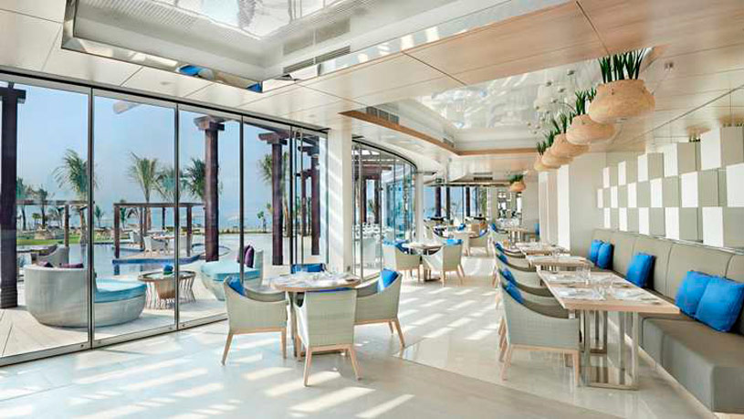 Palm Avenue poolside restaurant at  Waldorf Astoria Dubai Palm Jumeirah