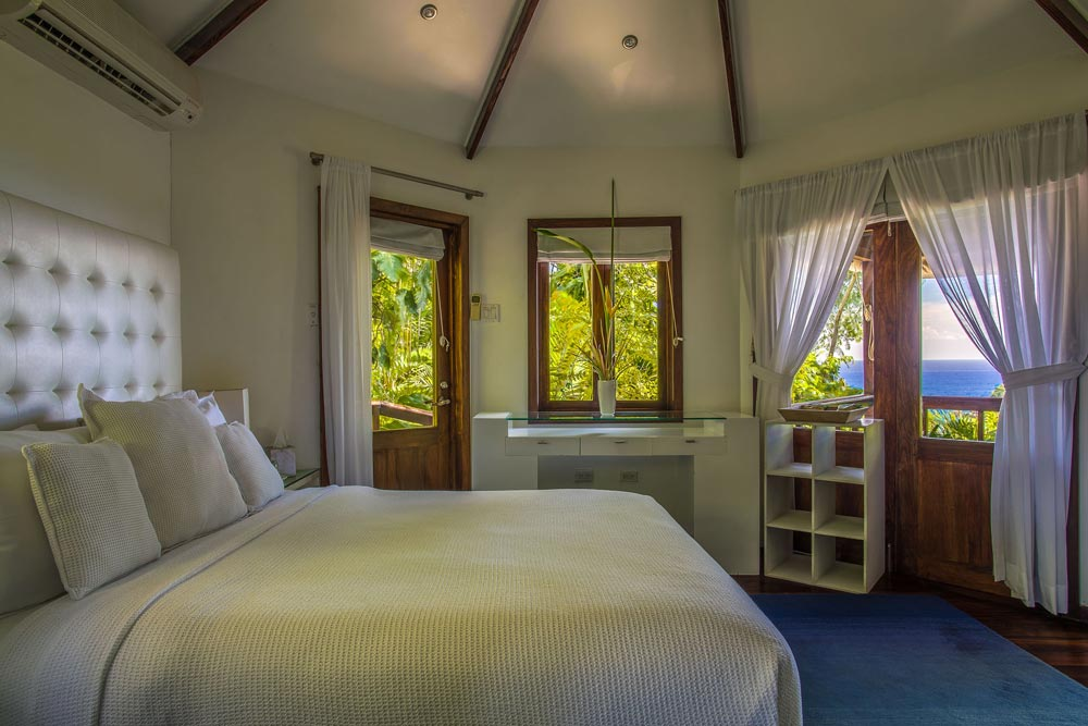 Highlighted by its lush rain forest surroundsMento is the ultimate nest for luxurious escape at the Geejam Hotel in Jamaica. This deluxe cabin also features an indoor bathroom with a steam room leading onto a patiocomplete with a Jacuzzi and hammock for morning and evening relaxation. Located in a private nicheMento fuses all the intimacy of a secluded hideaway. The cabins high ceilings and white linens lend an atmosphere of elegant minimalismcomplimented by a sweeping panoramic overlook of forest and sea from the extended veranda.