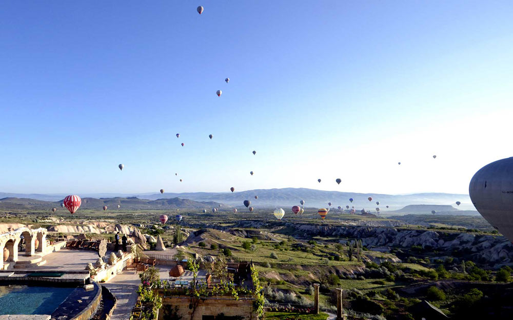 View of Museum Hotel Cappadoccia and surrounding valley from hot air balloon.