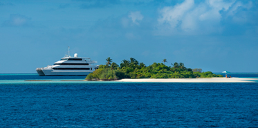 Four Seasons Explorer a 39meter3 deck catamaran takesup to 22 guests on a marine and cultural adventure into the undiscovered Maldives