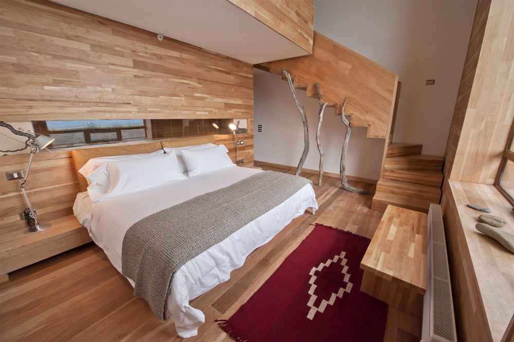 Split over two levelsthese generously sized suites (549 square feet 51 square meters) at Tierra Patagonia Hotel feature a cozy living room on the top floor and a large double room with ensuite downstairs