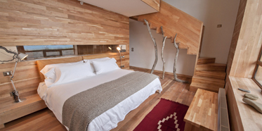 Split over two levels, these generously sized suites (549 square feet/51 square meters) at Tierra Patagonia Hotel feature a cozy living room on the top floor and a large double room with ensuite downstairs