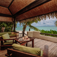 Premium Beachfront Bungalows are situated directly on the white sand beach framing Aitutaki s luminescent lagoon at Pacific Resort Aitutaki