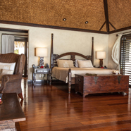Ultimate Beachfront Bungalow bedroom at Pacific Resort Aitutaki