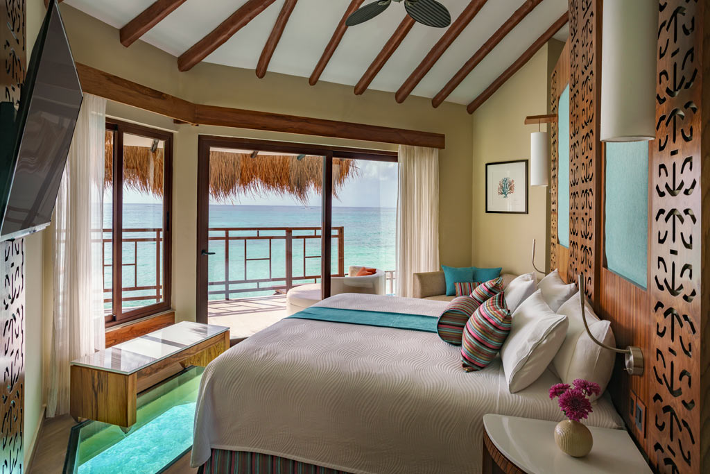Palafitos Overwater Bungalow Bedroom at El Dorado Maroma