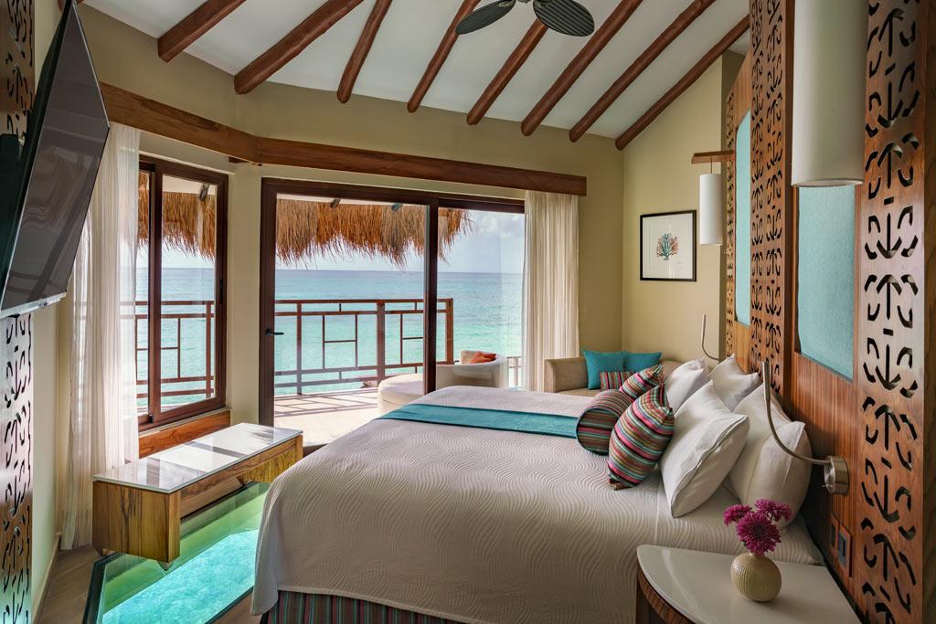 Palafitos Overwater Bungalow Bedroom at El Dorado Maroma