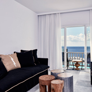 Superior Suite Lounge at Royal Myconian Resort and Thalasso Spa, Mykonos, Greece