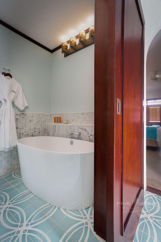 Deluxe Ocean View Room Bathtub at Peter Island Resort & Spa