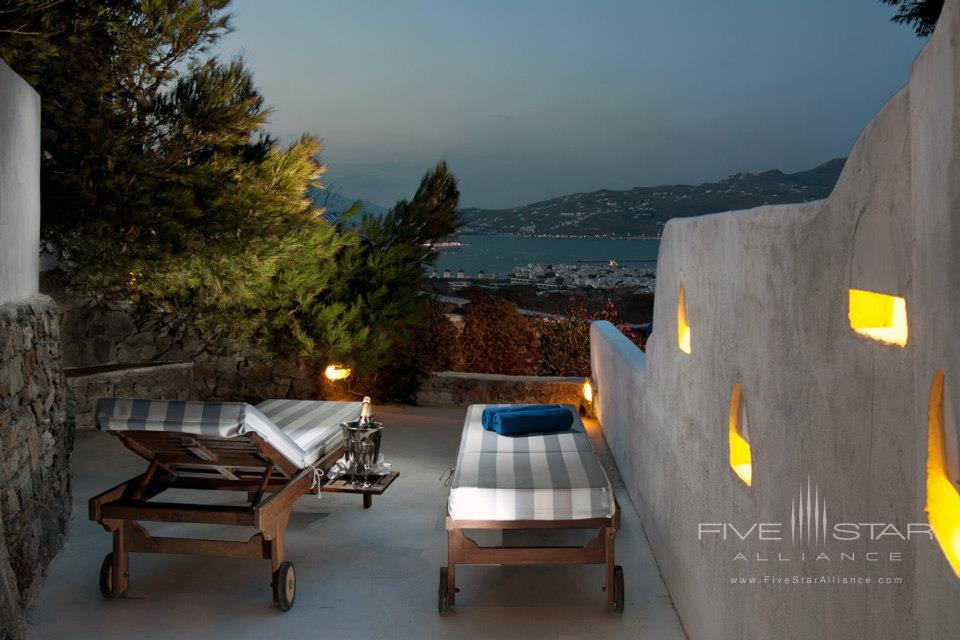 Enjoy a Glass of Wine Looking Over the Private Balcony at Tharroe Mykonos