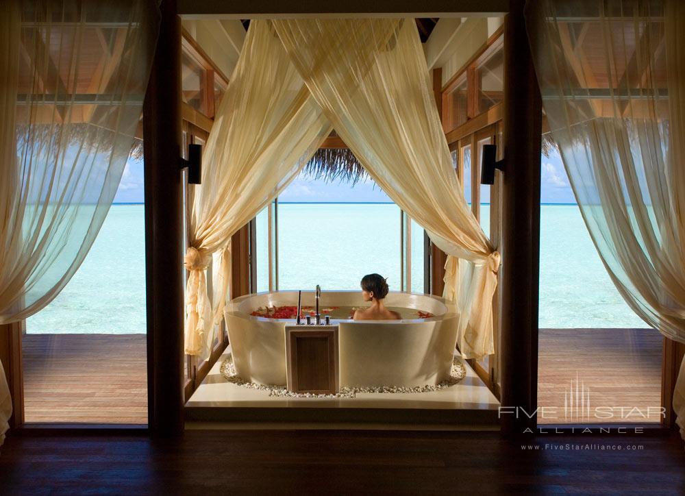 Overwater bungalow bath at Anantara Resort Dhigu Maldives