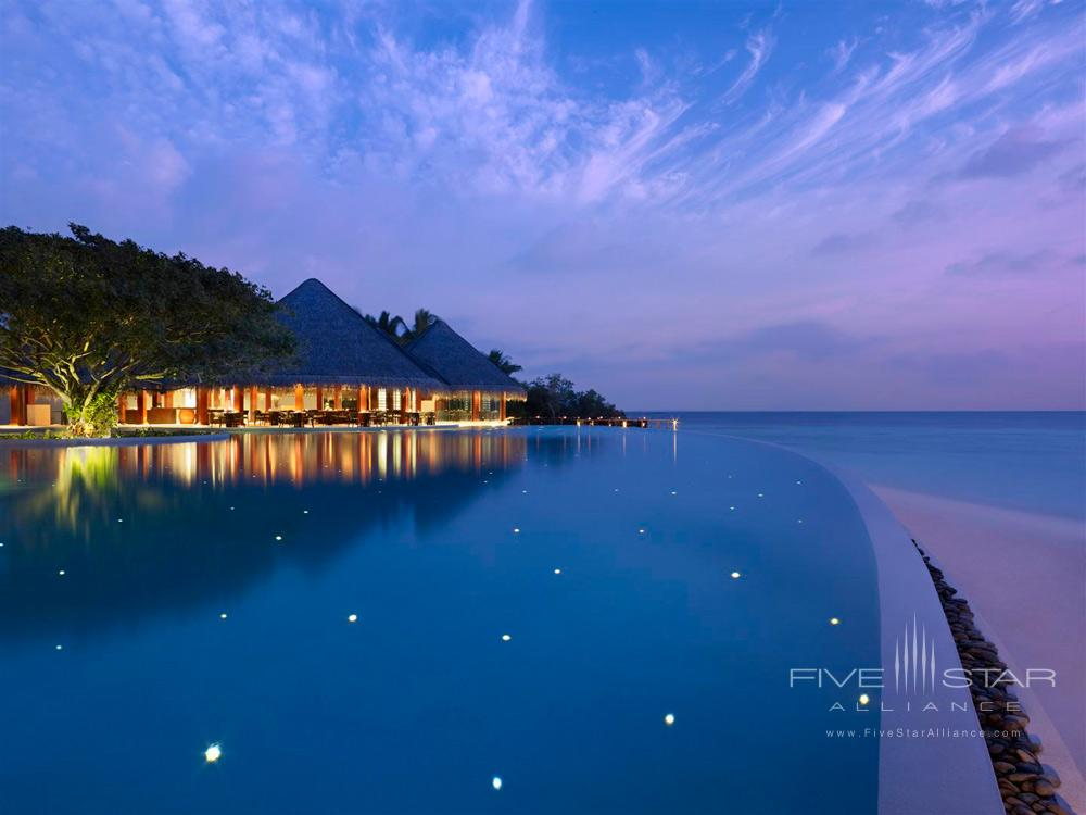 Pool by the Sea during Evening at Dusit Thani Maldives