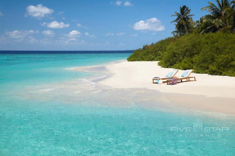 White Sandy Beach with Private Sun Lounges at Dusit Thani Maldives