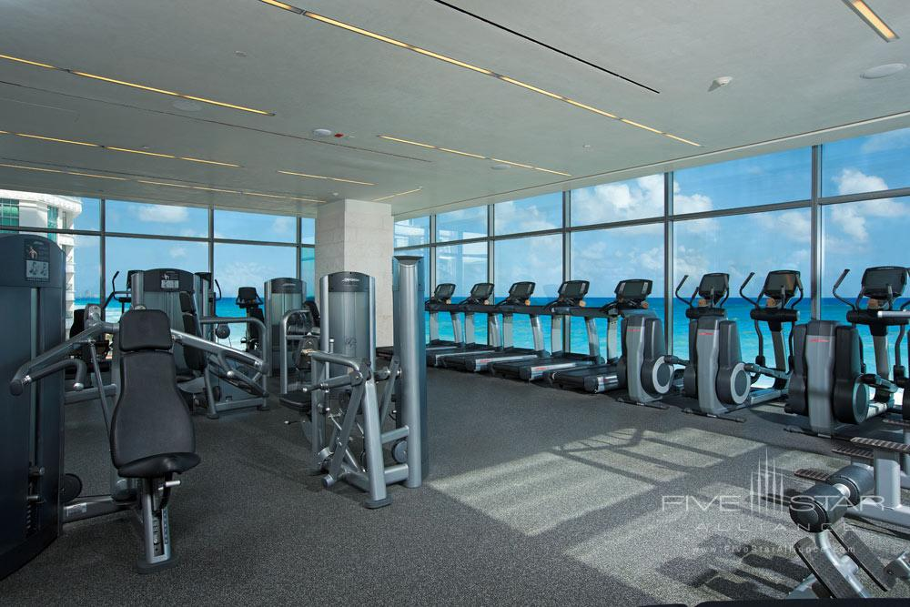 Fitness center overlooks the sparkling Caribbean at Secrets The Vine Cancun, Mexico