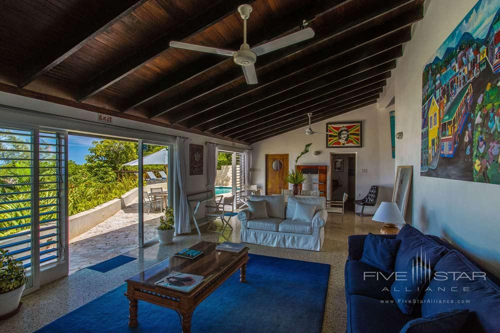 Sanwoodthe original villa at Geejam HotelPort AntonioJamaciawas designed by renowned British architect Anthony Wade in the late 1960s and is distinguished by a contemporary nautical theme. Included with the three guest rooms (SW1-3)are two upper deck verandasoutdoor swimming pooland media loungeall of which provide a stylishnext-level living environment.