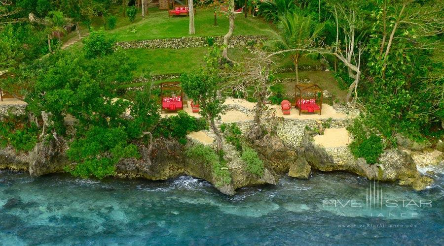 Geejam Beach is located at the foot of the Geejam Hotel in Jamaica. Thereyoull discover a natural cove that fits into the shoreline of the Caribbean Ocean with clear waterwhite sand and an uninterrupted horizon. Here you can swimsnorkelkayakpaddle board or simply relax on one of the four-poster beds. Molly Holea warm water natural springand Ital Batha skin-cleansing elixirare both located in secluded places for personal enjoyment and healing for your vacation. Broadband Internet wireless connection is available at Geejam Beach.