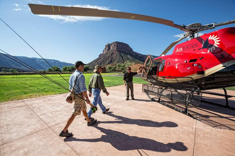 Guests Taking a Helicopter Lift to Enjoy Fishing at Gateway Canyons Resort and Spa