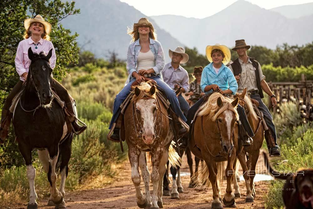 Family Enjoying Horseback Activity at Gateway Canyons Resort and Spa