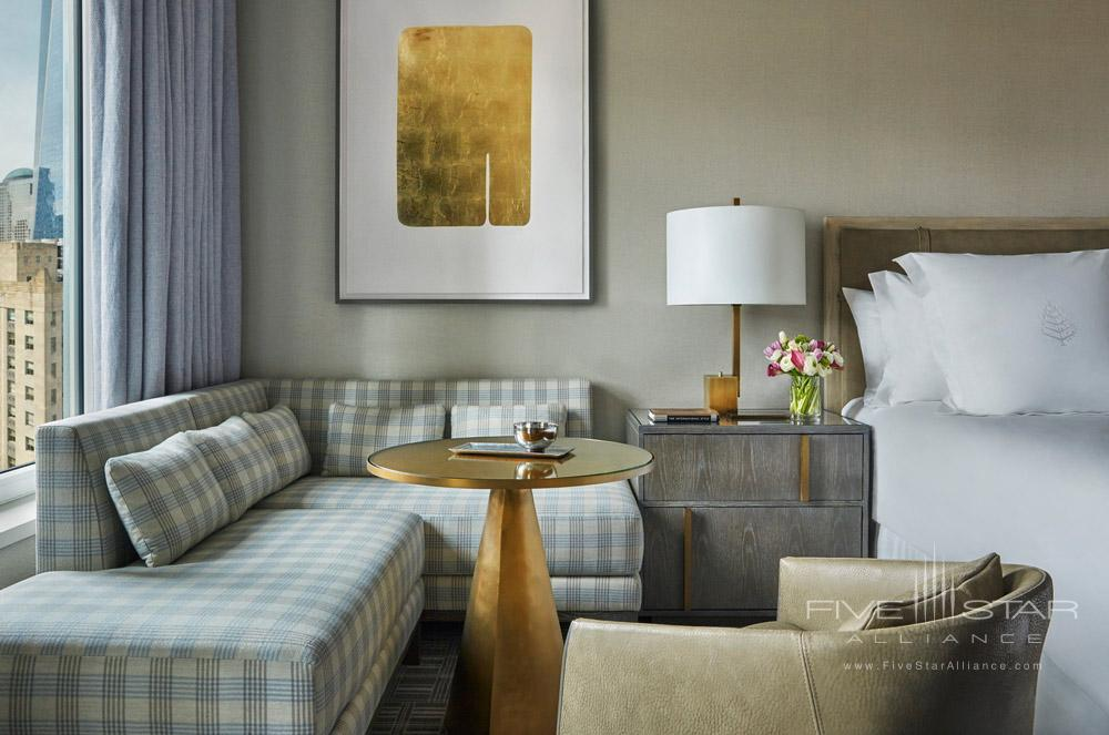 Guestroom with small sitting area at Four Seasons New York Downtown, NYC
