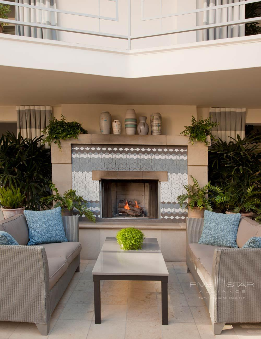 Lounge near the courtyard fireplace at Oceana Beach Club Hotel, Santa Monica, CA