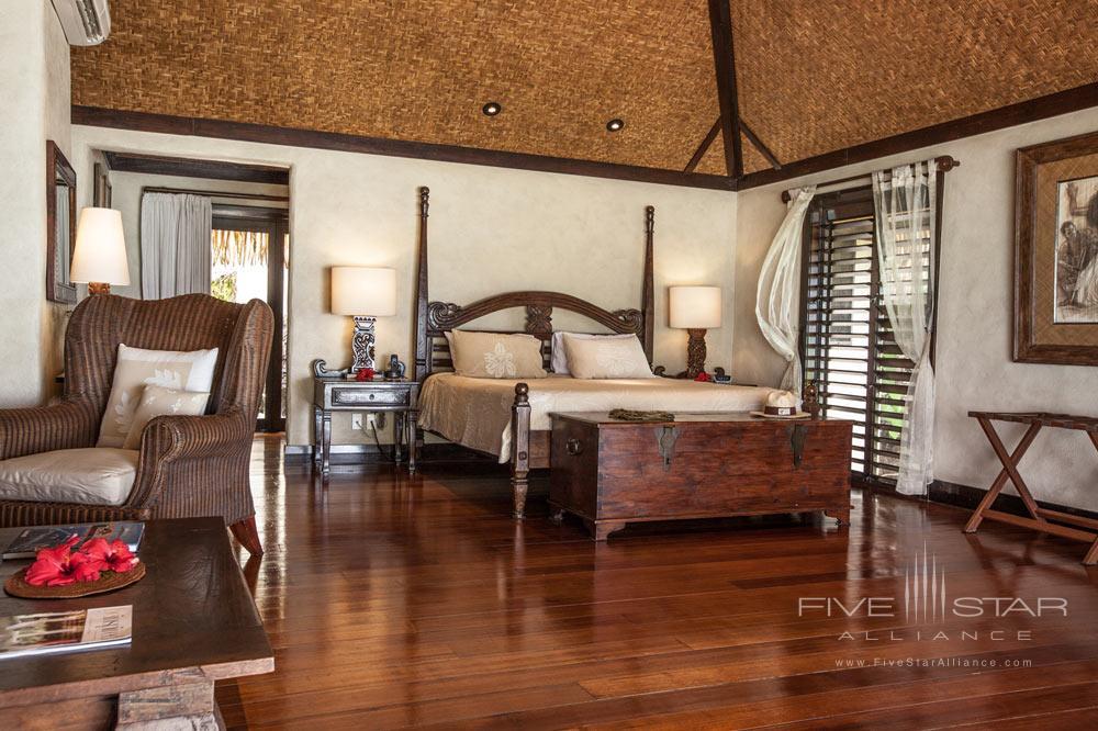 Ultimate Beachfront Bungalow bedroom at Pacific Resort Aitutaki