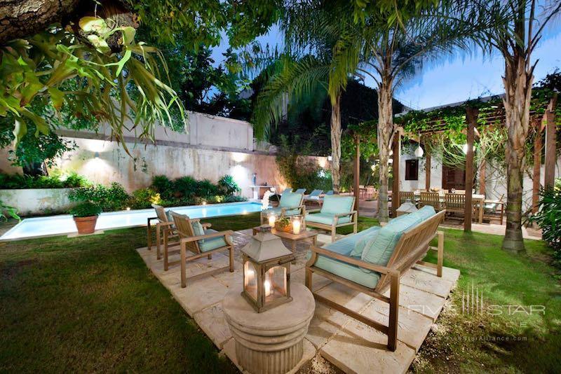 Outdoor seating around the pool at Casas del XVI in Santo Domingo