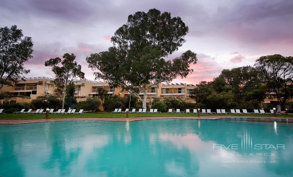 Sunset Over The Outdoor Pool at Sails in the Desert, Yulara, Australia