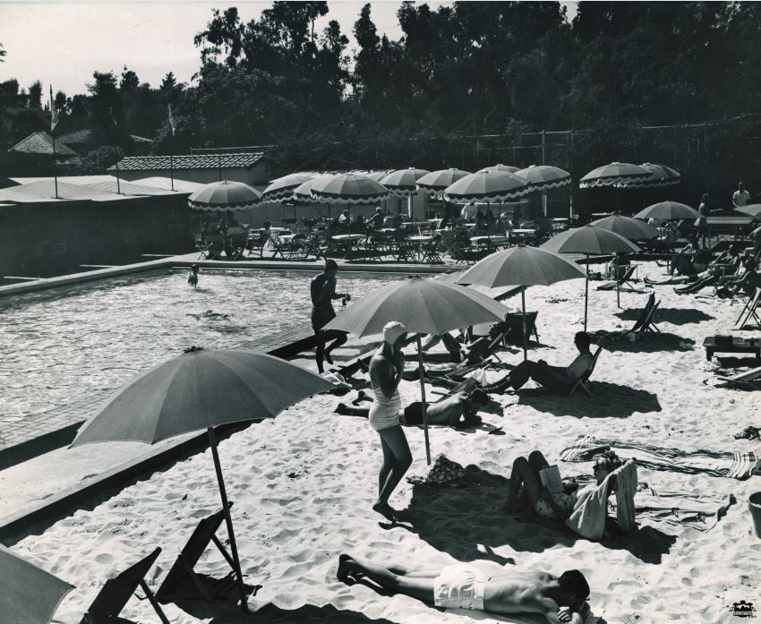 Before the signature green-and-white striped loungers at the Beverly Hills Hotel pool - there was sand! It was officially known as The Beverly Hill's Sand and Pool Club (photo circa 1938).