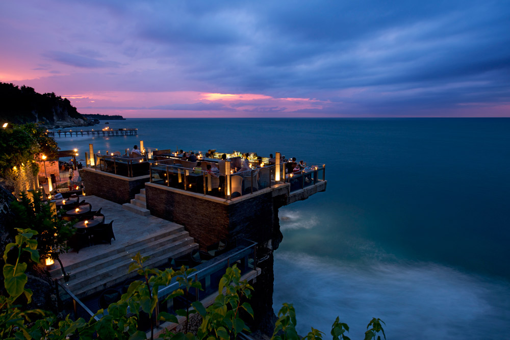 Located on natural rocks 14 meters above the Indian Ocean at the base of AYANA Resort and Spa Bali's towering cliffs, this innovative open-top Bali bar is the island'smost glam sunset and after-dark destination