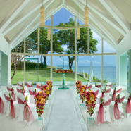 Tresna wedding chapel in Bali,, available for booking through AYANA Resort and Spa, is a dramatically-illuminated chapel that majestically towers above the Indian Ocean. It features a see-through glass aisle with a flowing, stone-lined river underneath that leads to a magnificent glass altar