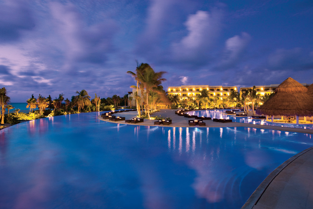 Night view of the infinity pool at Secrets Maroma Beach Riviera Cancun in Playa Del Carmen, QR, Mexico
