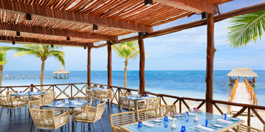 Dine by the beach at Azul Beach Hotel, Puerto Morelos, Mexico