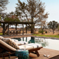 Outdoor Lounge and private pool at Singita Boulders Lodge overlooking the 45,000 acre game reserve in the Sabi Sand Reserve adjacent to the Kruger National Park