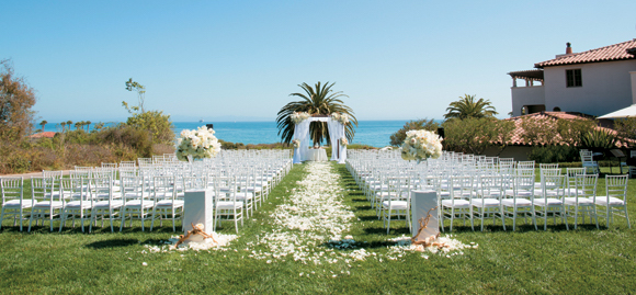 The Ocean Lawn at Bacara Resort & Spa affords panoramic ocean views for a wedding ceremony and is surrounded by the resort's lush landscaping.