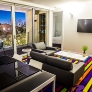 Eastside Lounge and Bedroom at ADGE Apartment Hotel Sydney